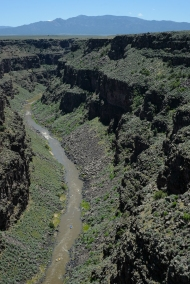 Rio Grande in its gorge sweeping rafters along.