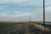 It was crazy windy because I was on an enormous plateau, and still had not reached the heart of the Rocky Mountains at this point. The dust storm is a result of poor farming practices. All the dry fields without crops were nothing but sand pits. This is the result. An utter mess.